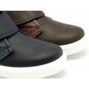 Ankle boots tennis style with velcro strap in nappa leather combined with canvas.